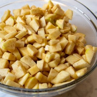 chopped cinnamon sugar apples in a large mixing bowl