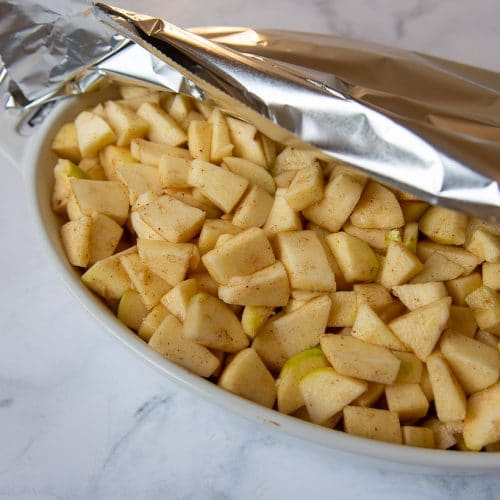 foil partially covering apple filling before baking