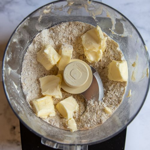 butter about to be mixed in crisp topping