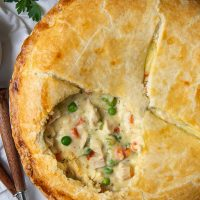overhead shot of chicken pot pie with a circle opening in the crust