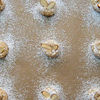 overhead shot of almond cookies with sliced almonds and powered sugar