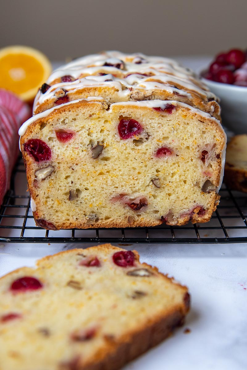 gluten free cranberry bread sliced and facing straight out on a cooling rack