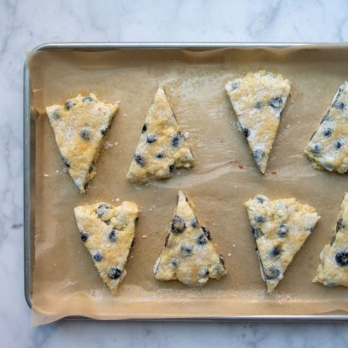 unbaked scones on baking sheet