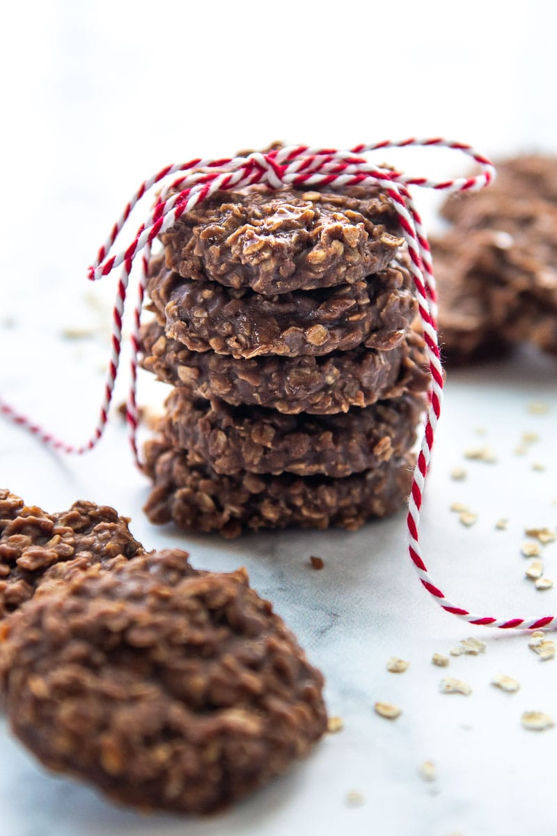 a stack of no bake cookies with red string tied around them