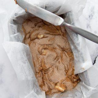 cinnamon topping sprinkled on unbaked bread