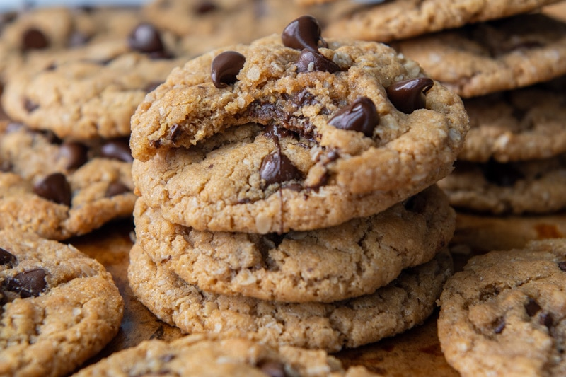 a stack of cookies with a bite taken out of the top one