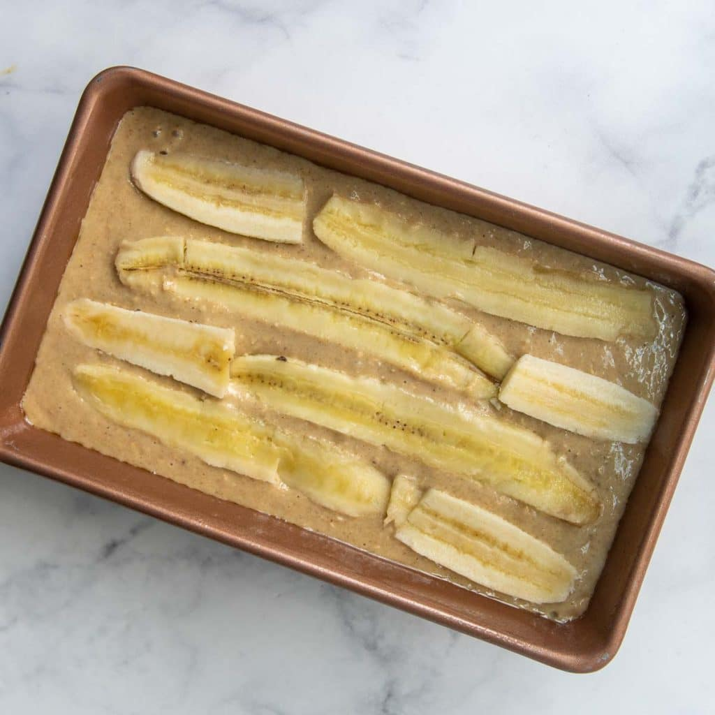image showing unbaked bread with sliced bananas on top