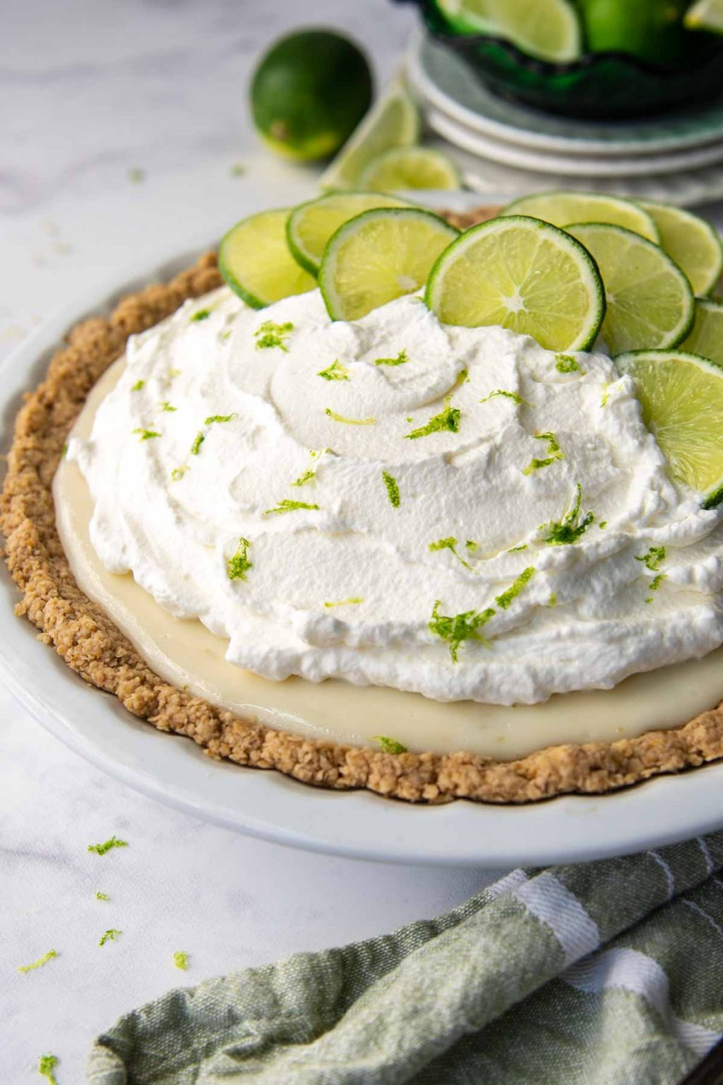 key lime pie with oat flour crust and green linen next to it