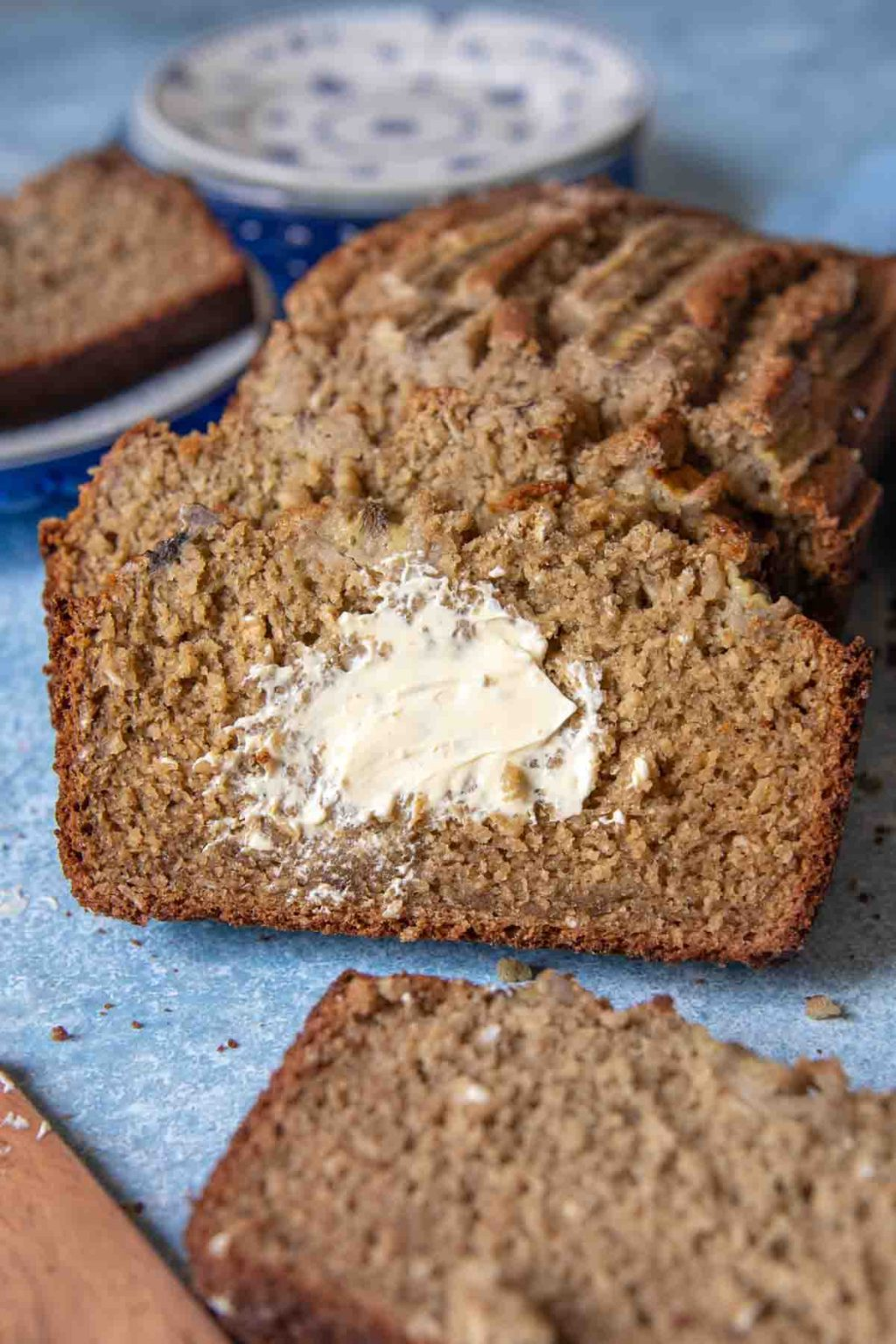 a slice of bread with melted butter spread on