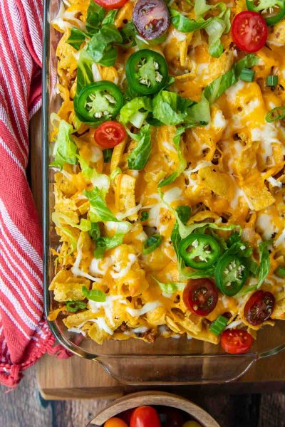 overhead shot of casserole with cheese, tomatoes, and jalapenos on top
