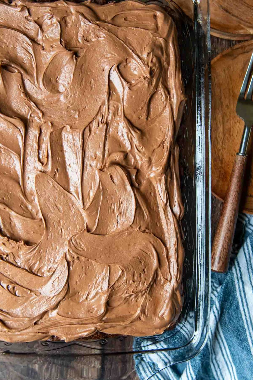 overhead shot of chocolate zucchini cake with chocolate frosting