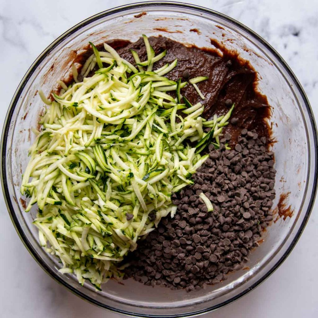 images showing adding grated zucchini to the cake batter