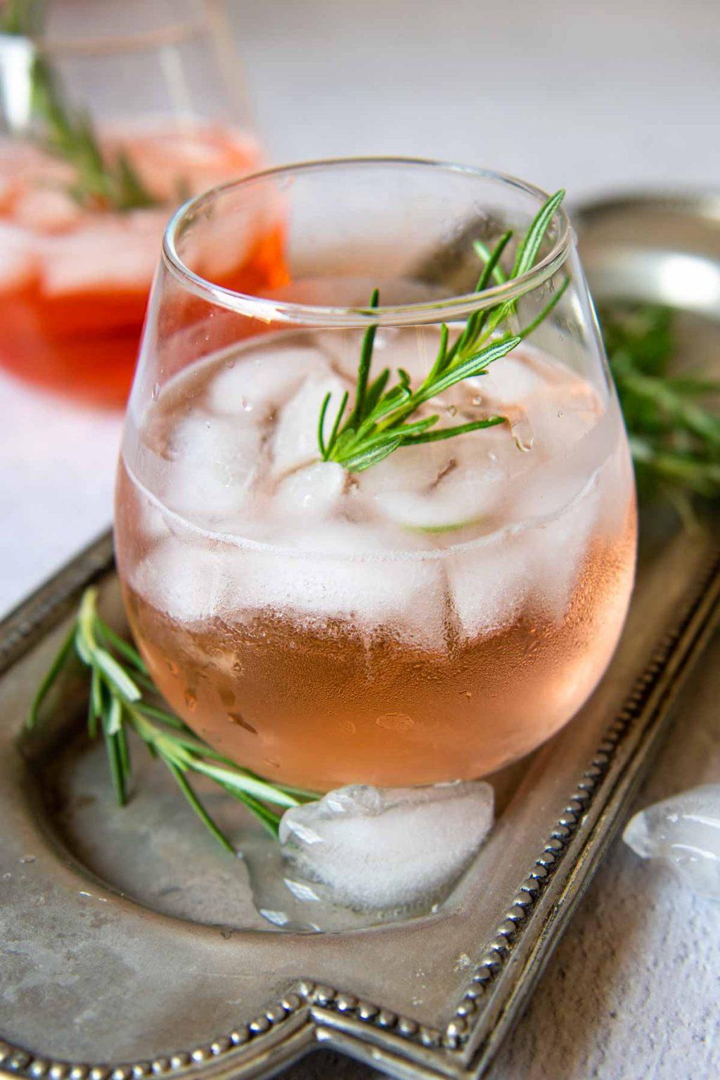 a rose spritzer on a silver drink platter