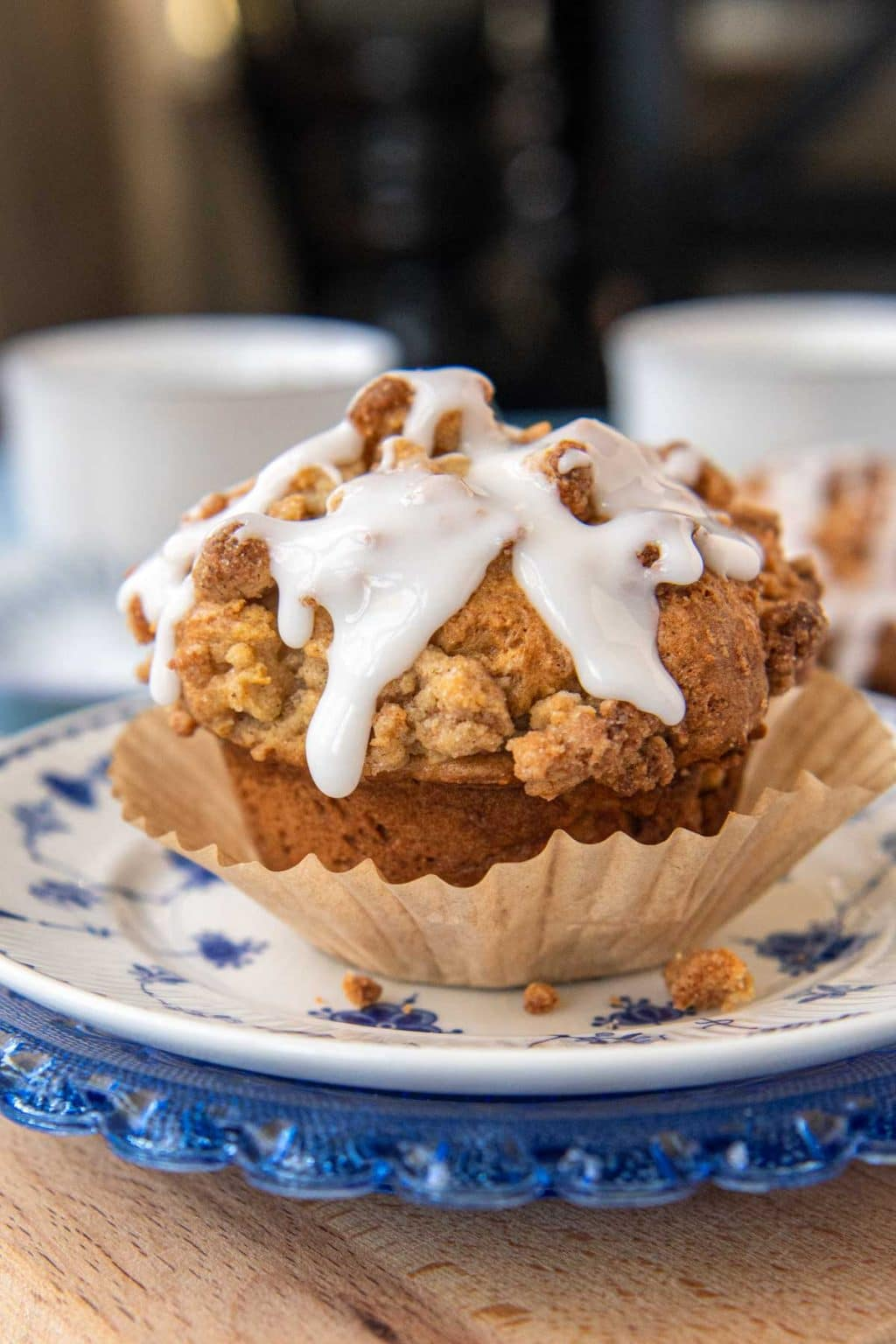 a gluten-free apple muffin partially unwrapped from a paper liner