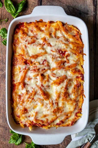 overhead shot of baked ziti in a white baking dish