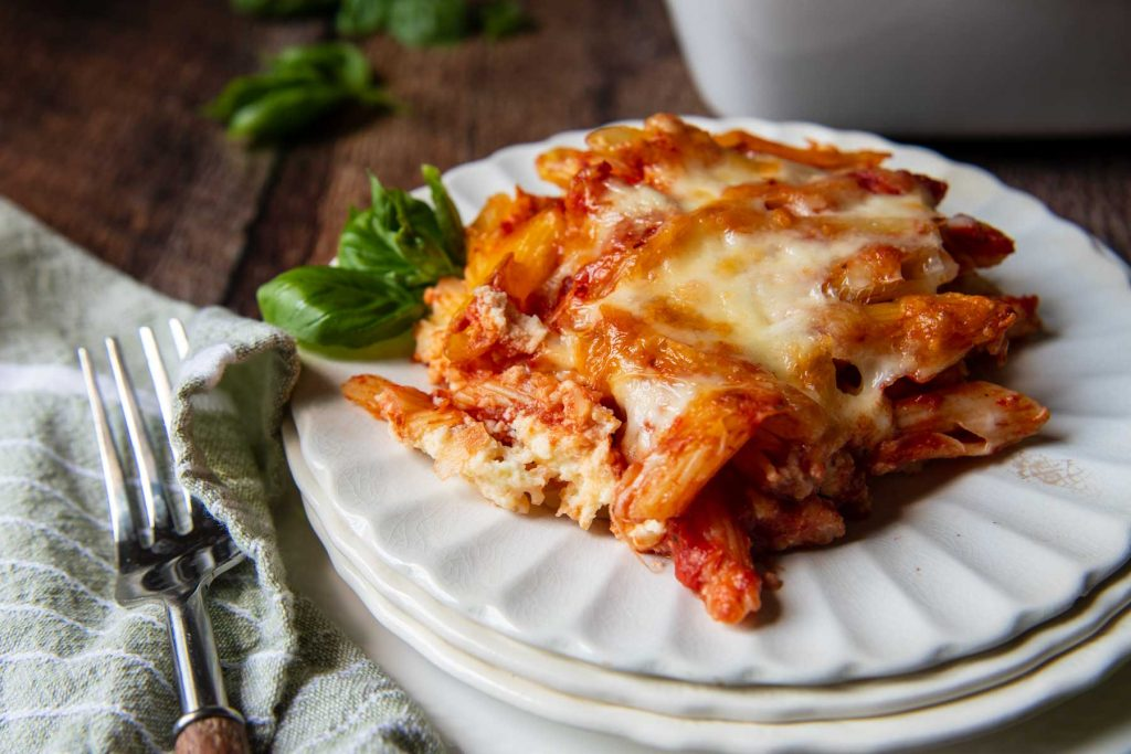 a serving of meatless baked ziti on a white plate