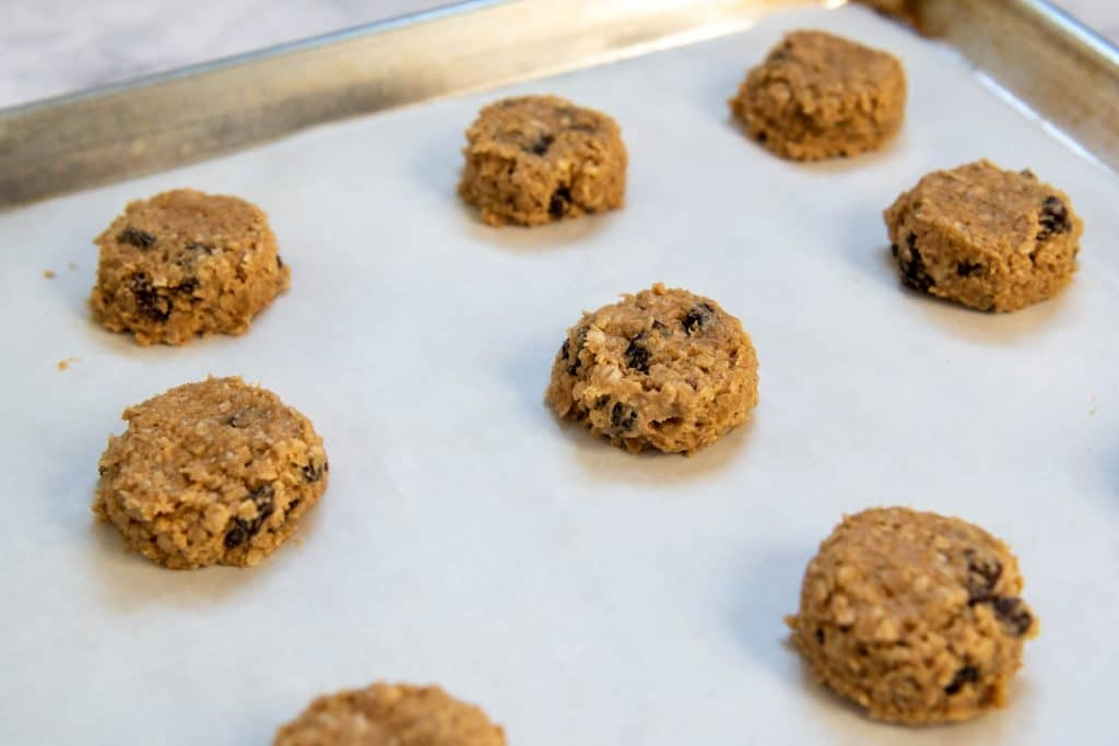 unbaked cookie dough on a cookie sheet